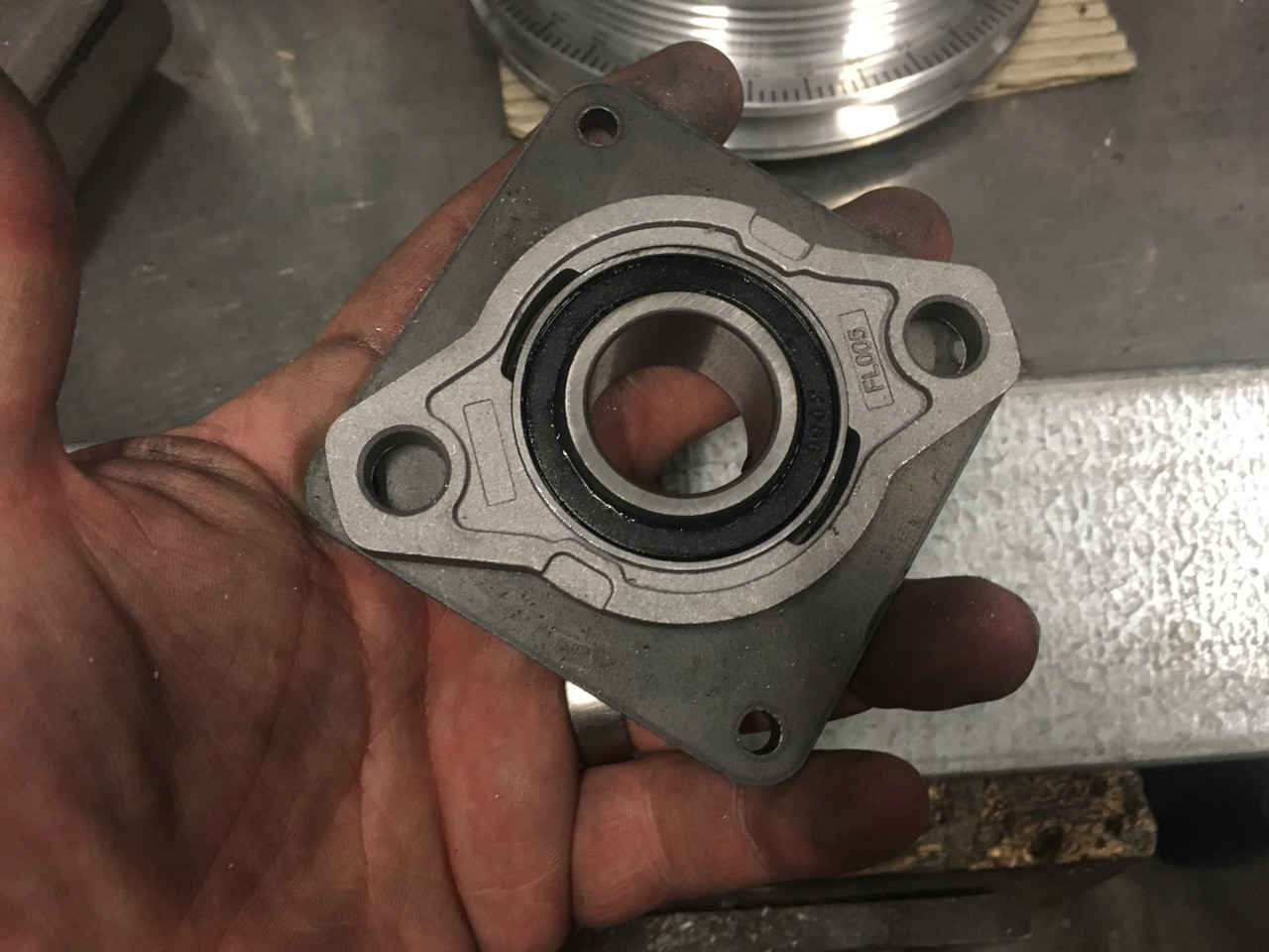 Mearing in moutning plate - The bearing sits inside of the mounting plate
