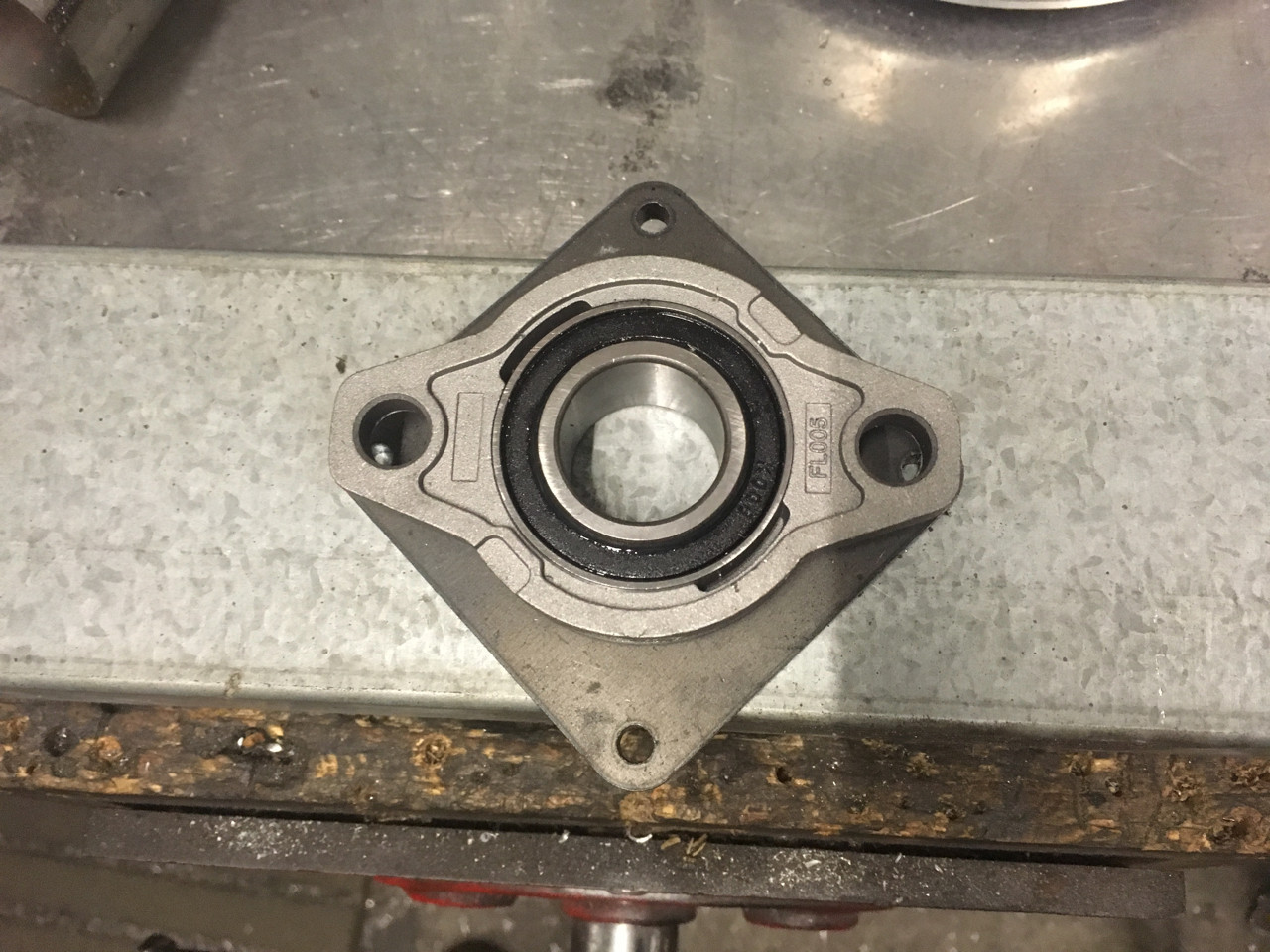 Bearing in position - The mounting plate will be welded and trimmed to it the chassis rails. The plate provides the support for the bearing, otherwise all of the weight is on the two mounting bolts and a tiny bit of alloy on the bearing ears